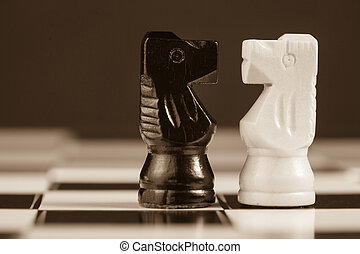 Two chess knights facing each other