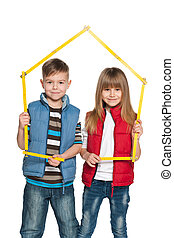 Two children are holding model of a house