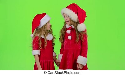 Two children are talking about the celebration of the new year. Green screen