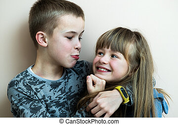 Two children boy and girl fooling around having fun together. Happy childhood concept.