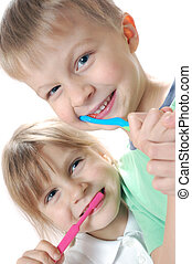 two children cleaning teeth over white background