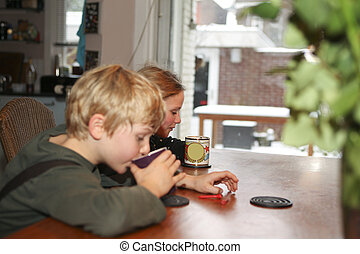 Two children drinking at home