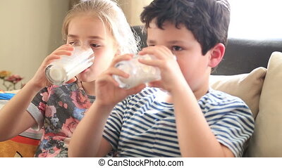 Two children drinking milk