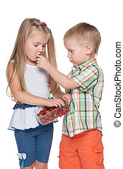 Two children eat strawberry