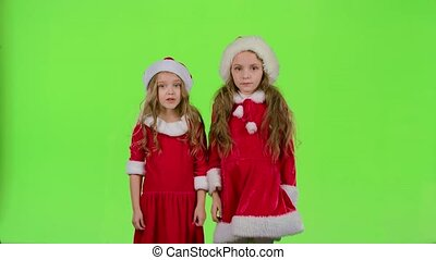 Two children girls swear and argue, they are in colorful...