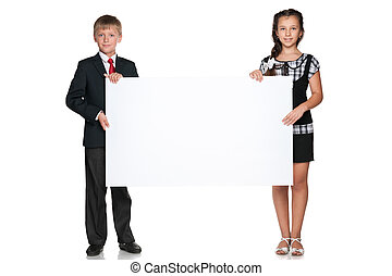 Two children hold a white board