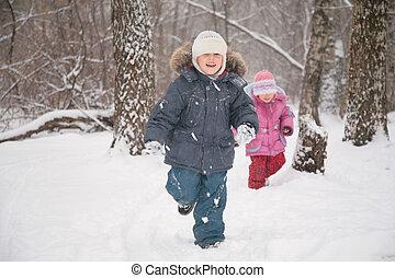 two children in forest in winter