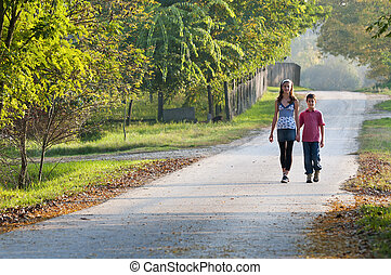 Two children on country road