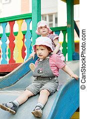 two children on slide