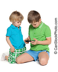 Two children plaing with smartphone