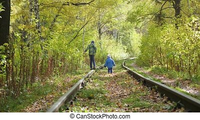two children play on the empty rail
