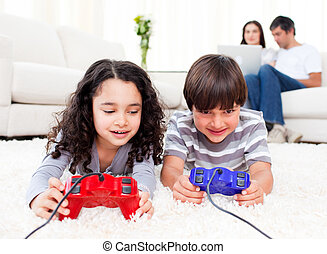 Two children playing video games wi