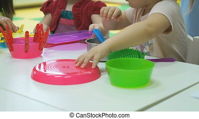 Two children playing with children's tableware - Two...