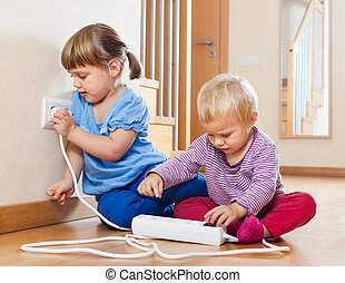 Two children playing with electricity - Two children playing...