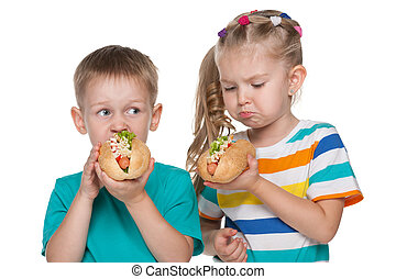 Two children with hot dogs