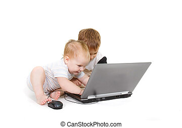 two children with laptop over white