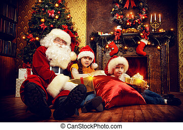two children with Santa