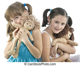 Two children with their favorite dolls