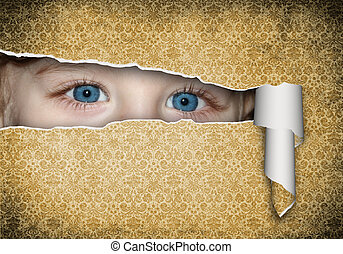 children's eyes - Two children's eyes with a paper hole