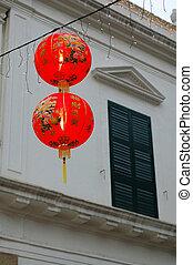 Chinese lanterns - Two Chinese lanterns hanging in front of ...