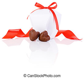 Two chocolate candies in heart shape, white box and red ribbon Isolated on white background