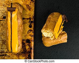 Two Choux Pastry Orange Eclairs