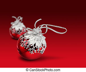 Two Christmas balls red background