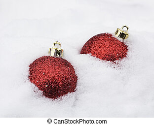 two christmas baubles in white snow