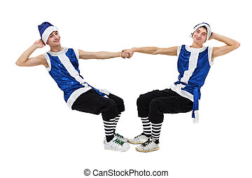 two Christmas men in blue santa clothes dancing against isolated white in full length.