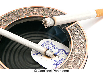 two cigarettes and portrait of child in ashtray