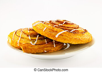 Two Cinnamon Buns on a White Plate