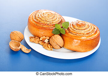 Two cinnamon rolls on plate