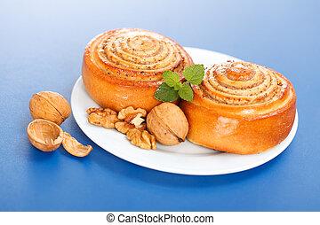 Two cinnamon rolls on plate