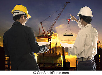 two civil engineer working in building construction site...