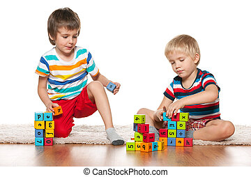 Two clever boys with blocks