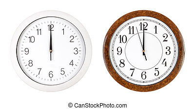 Two clock faces showing twelve o'clock