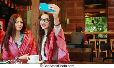 two close friends do selfie in the cafe
