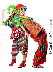 Two clowns are back to back. Isolated on white