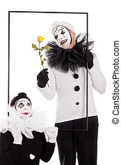 two clowns in a frame with flower