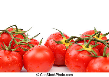 Two clusters of small red tomatoes on a branch