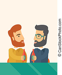 Two co- workers having fun drinking beer in a pub. - A two...