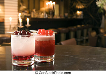 Two cocktails with Gin and Sherry, decoradet with cherries