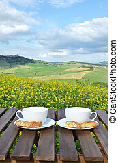 Two coffee cups and cantuccini on the wooden table against ...