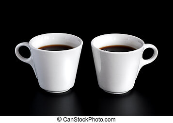 two coffee cups - two white coffee cups isolated on a black...