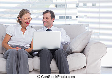 Two colleagues using laptop