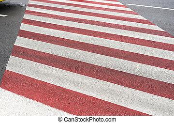 marking of a pedestrian crossing on asphalt