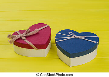Two colorful heart shaped gift boxes.