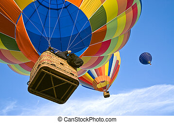hot air balloons - two colourful hot air balloons running...