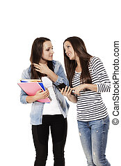 two communicating teenage students with a smartphone on white background