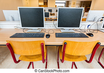 Two computers in classroom on high school